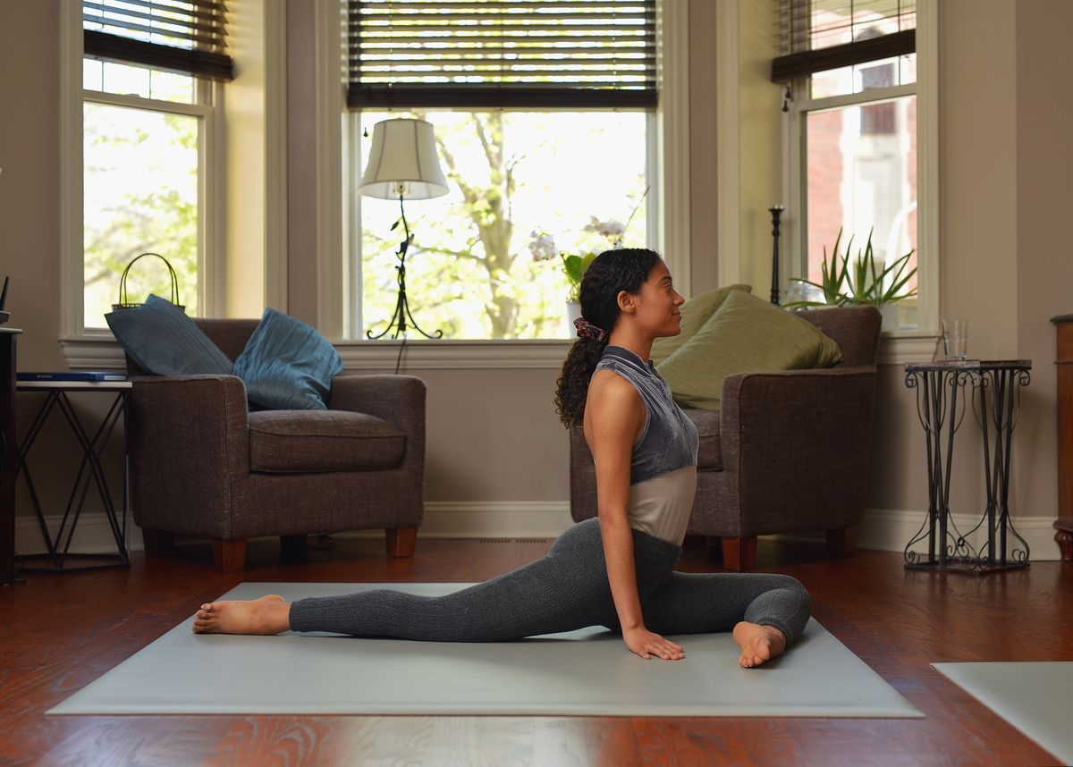 """Joffrey Ballet dancer Princess Reid demonstrates her favorite at-home workout exercises, the """"pigeon pose,"""" which helps to elongate the back, stretches the hip flexors, and can alleviate pressure on the low back."""