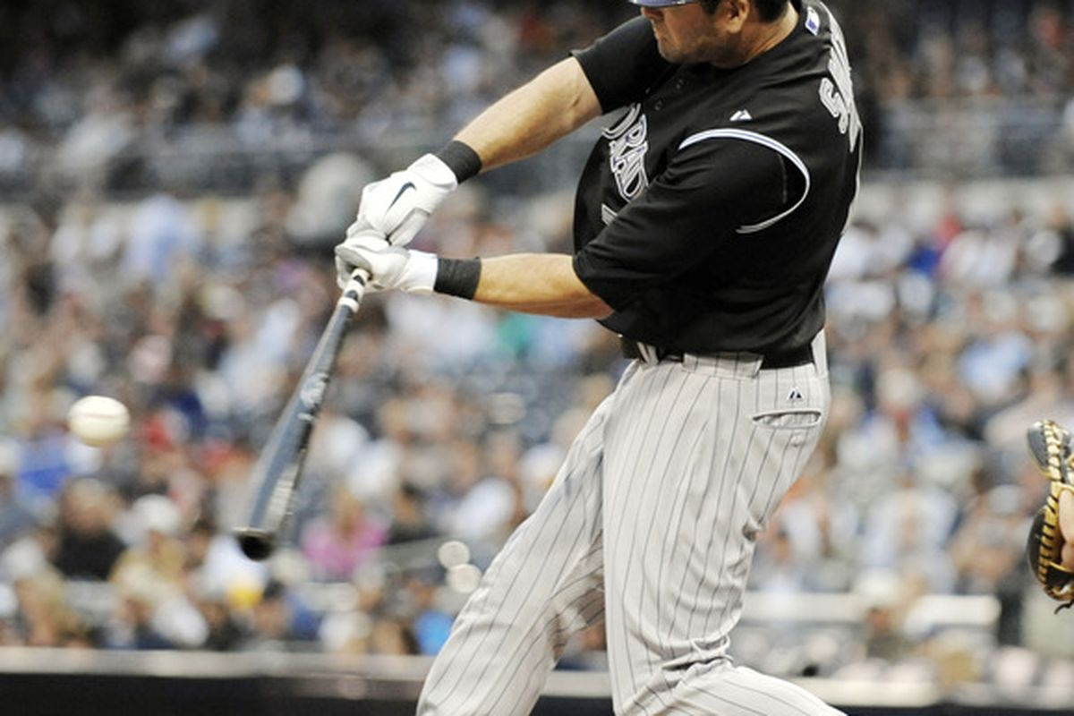SAN DIEGO, CA - JULY 29:  Seth Smith #7 of the Colorado Rockies connects for a single in the second inning of a baseball game against the San Diego Padres at Petco Park on July 29, 2011 in San Diego, California.  (Photo by Denis Poroy/Getty Images)