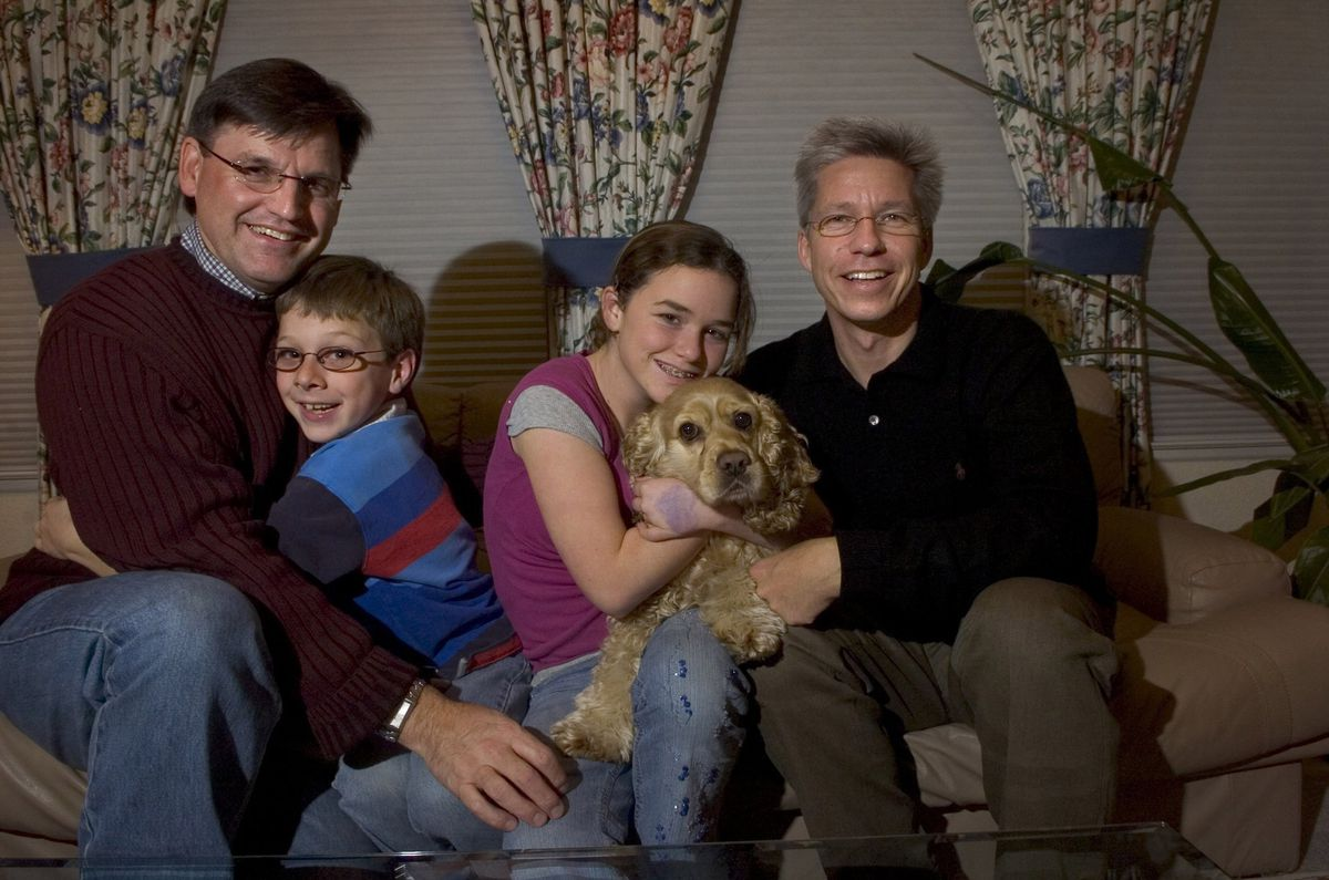 A family with same-sex parents.