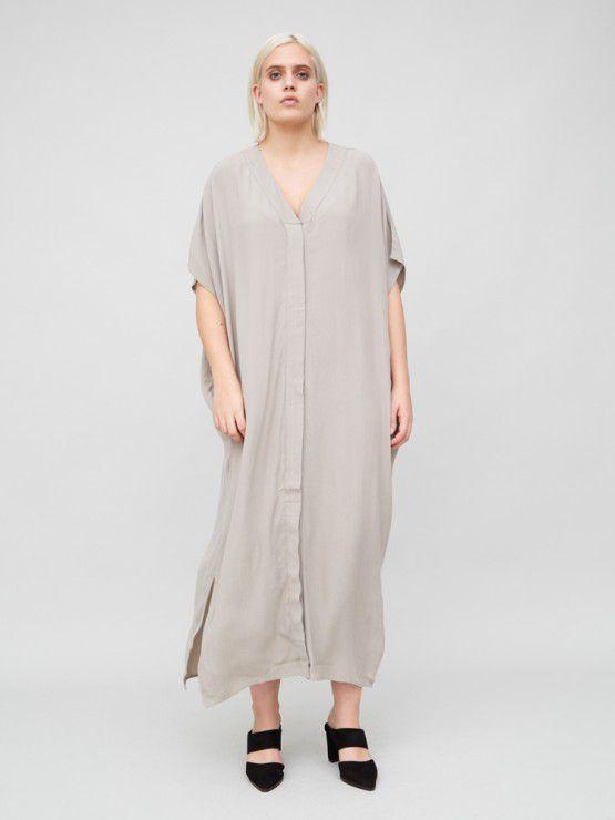 A blonde model wears a flowey, loose kimono dress in taupe