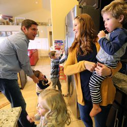 From left, Kyle, Max, Millie, Oliver, Emily and Simon Widdison chat in their kitchen at home in Saratoga Springs, Utah, Friday, Jan. 8, 2016.
