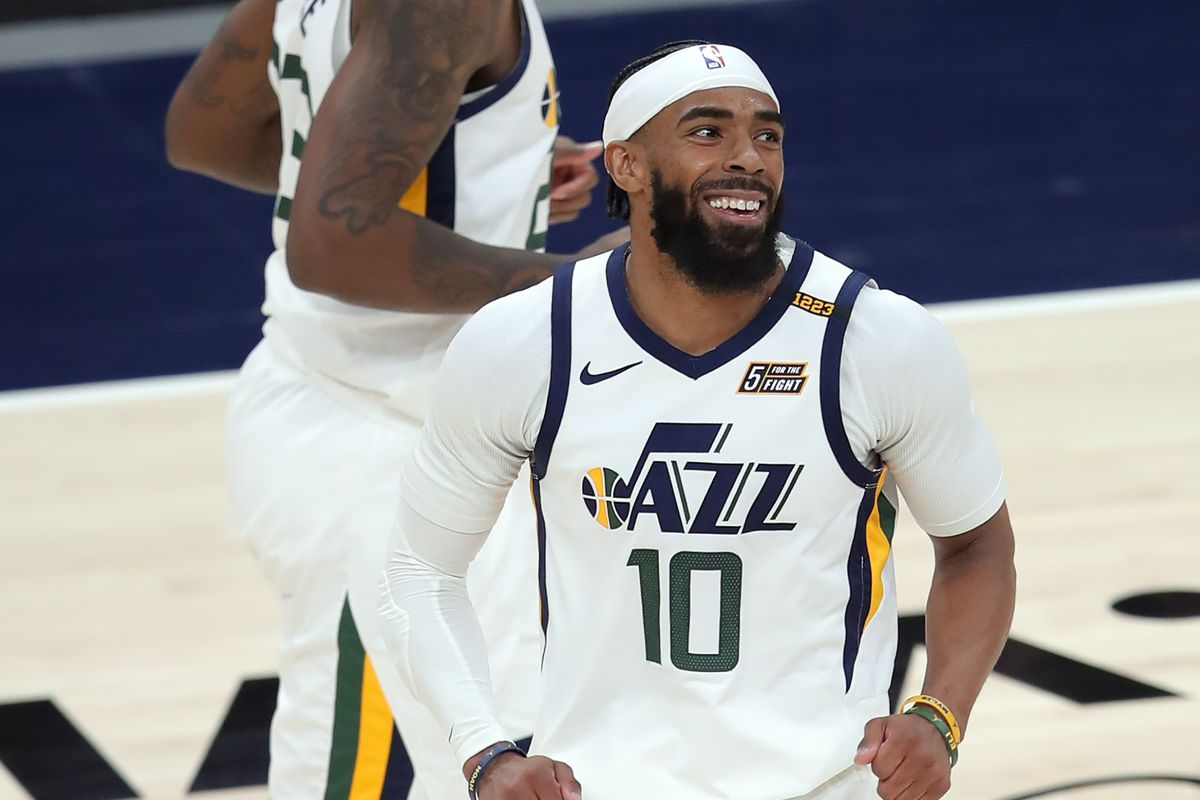 Utah Jazz guard Mike Conley smiles after dropping a 3-point shot as the Jazz and Sacramento play in Salt Lake City.