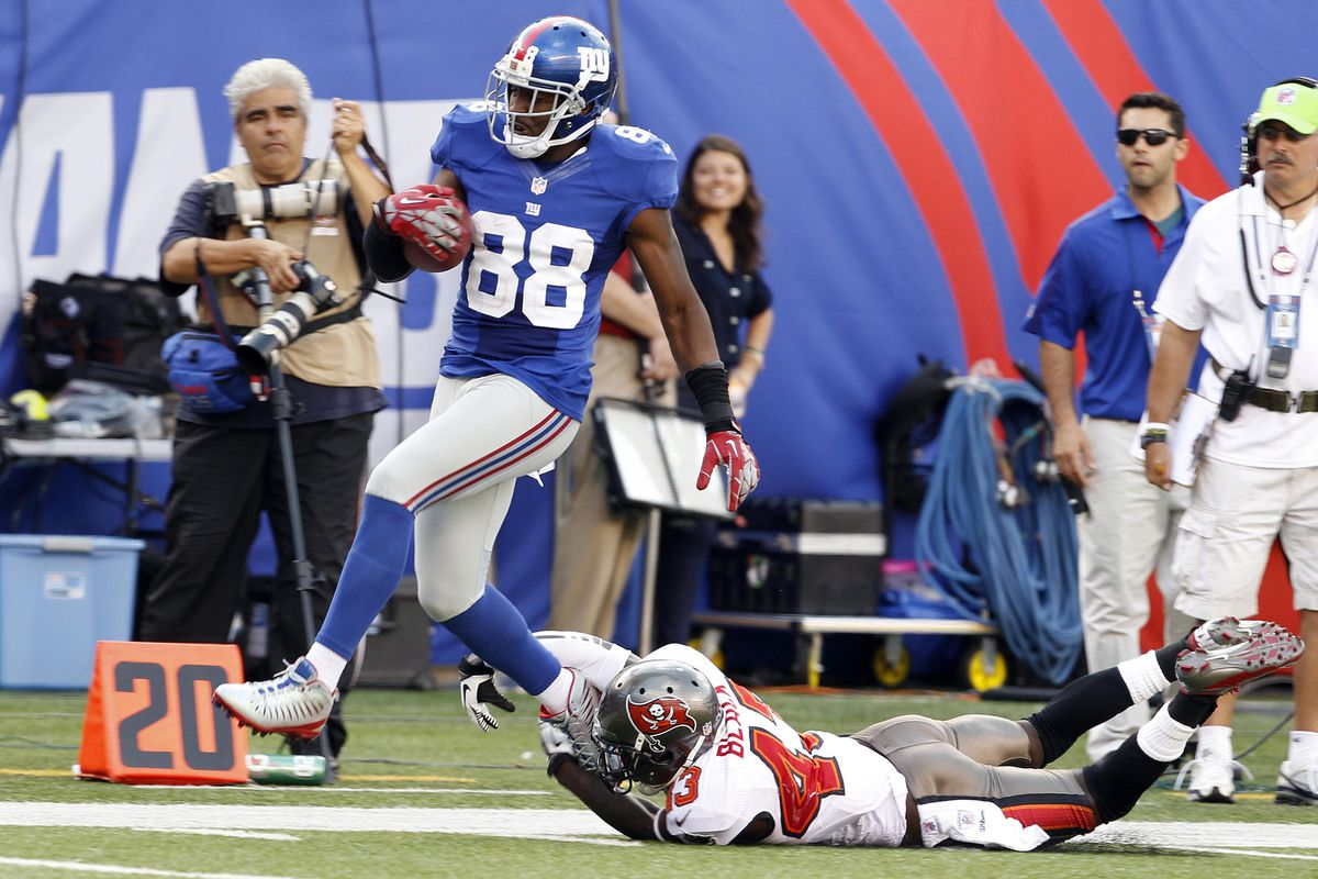 Sep 16, 2012; East Rutherford, NJ, USA; New York Giants wide receiver Hakeem Nicks (88) runs past Tampa Bay Buccaneers free safety Ahmad Black (43) during the game at MetLife Stadium.  William Perlman/THE STAR-LEDGER via US PRESSWIRE