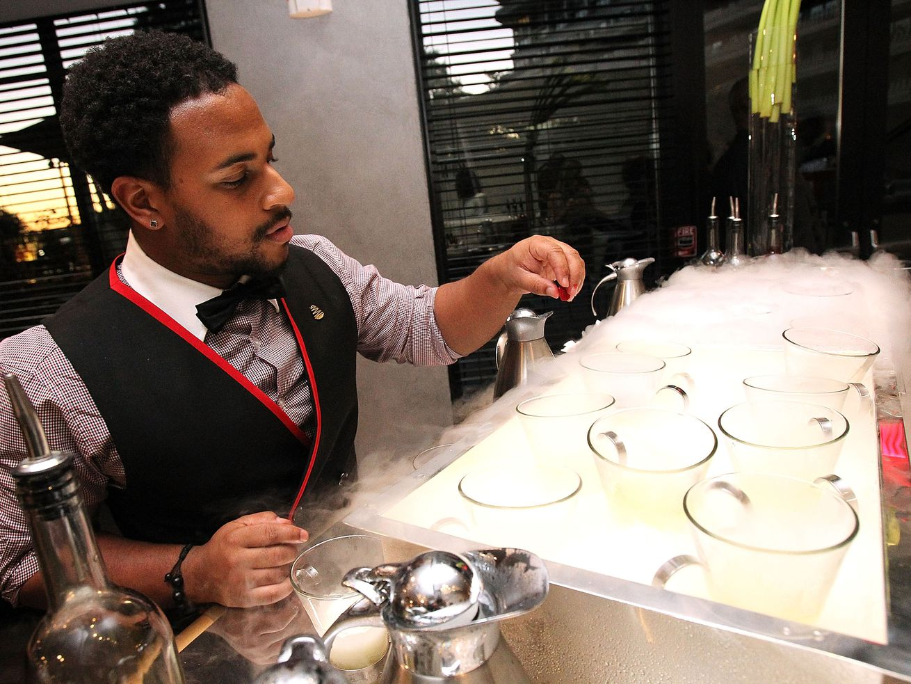 A bartender prepare cocktails at the Kingbird restaurant in the Watergate Hotel on June 14, 2016, in Washington, DC.