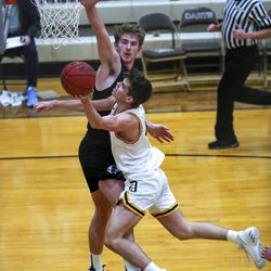 Davis guard Rex Sunderland tries to get past Layton's Ethan Potter during a boys basketball game at Davis High School in Kaysville on Friday, Jan. 22, 2021.