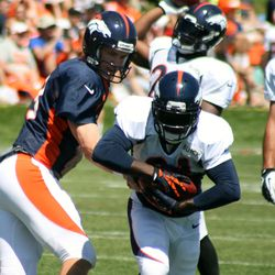 Broncos QB Peyton Manning hands off to RB Ronnie Hillman at training camp day six
