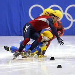 USA' s Apollo Ohno tangles and crashes on the last turn of the men's 1,000 meter short-track speedskating Saturday, Feb. 16, 2002, at the Salt Lake Ice Center. Behind Ohno is Korea's Hyun-Soo Ahn and Canada's Mathieu Turcotte. Australia's Steven Bradbury won the gold. Ohno took the silver.