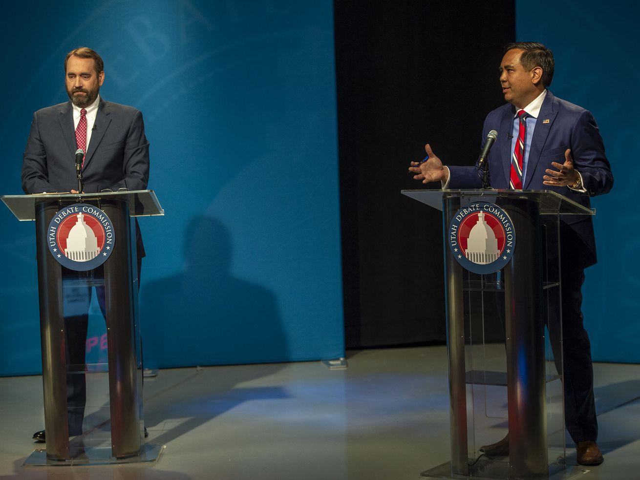 Utah County Attorney David Leavitt, left, listens as Utah Attorney General Sean Reyes speaks during the Utah attorney general Republican primary debate at the PBS Utah studios in on Tuesday, June 2, 2020.