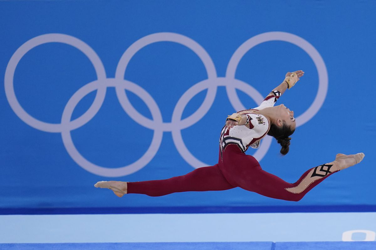 Pauline Schaefer-Betz, of Germany, performs her floor exercise routine at the Tokyo Olympics in a full-body unitard.