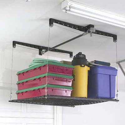 An anchored holiday decoration storage unit hanging from a garage ceiling.
