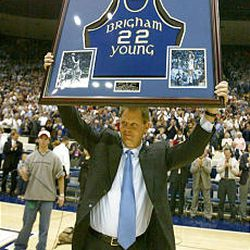 Former Brigham Young player Danny Ainge hoists his framed college jersey during a number retirement ceremony in his honor Saturday, March 8, 2003, during halftime of the BYU-Colorado State game in Provo, Utah. Ainge is the all-time leading scorer for BYU, playing from 1978-81. (AP Photo/George Frey)