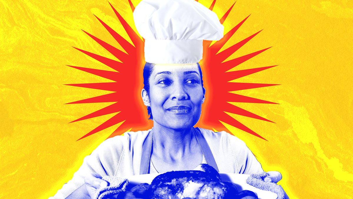 A woman wearing a chef's hat holds up a platter of food.