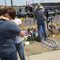 Juliann Ashcraft, of Prescott, the wife of Andrew Ashcraft, who was killed battling the Yarnell Hill Fire hugs Andrew's father, Tom Ashcraft of Prescott in front of Prescott Fire Station #7 on Monday, July 1, 2013. Nineteen firefighters have died in the Yarnell Hill Fire that has ripped through half of the town and sent residents to Prescott for safety. (AP Photo/The Arizona Republic, David Wallace)