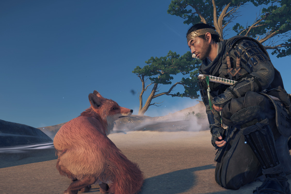 The main character in Ghost of Tsushima and a fox on a beach