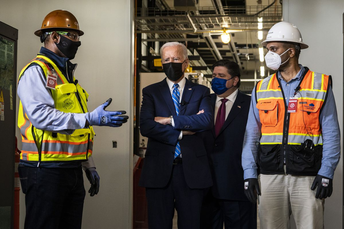 President Joe Biden joins Gov. J.B. Pritzker and workers on a tour of a data center under construction by Clayco in Elk Grove Village, Thursday afternoon, Oct. 7, 2021.
