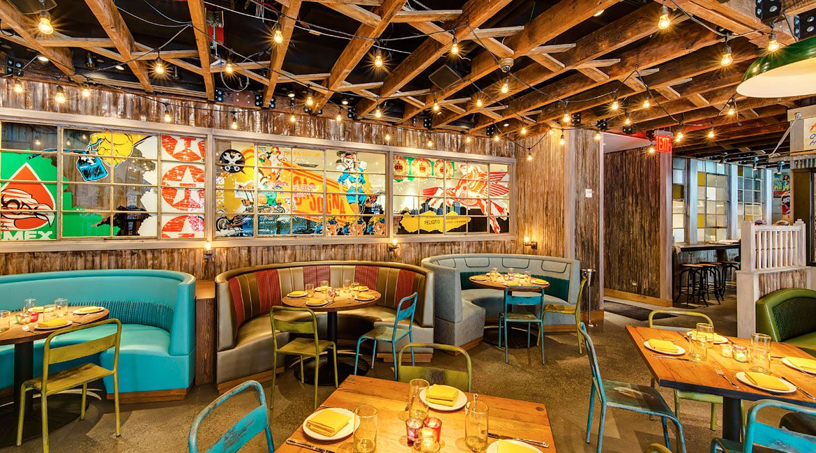 El Vez's colorful dining room with a teal booth