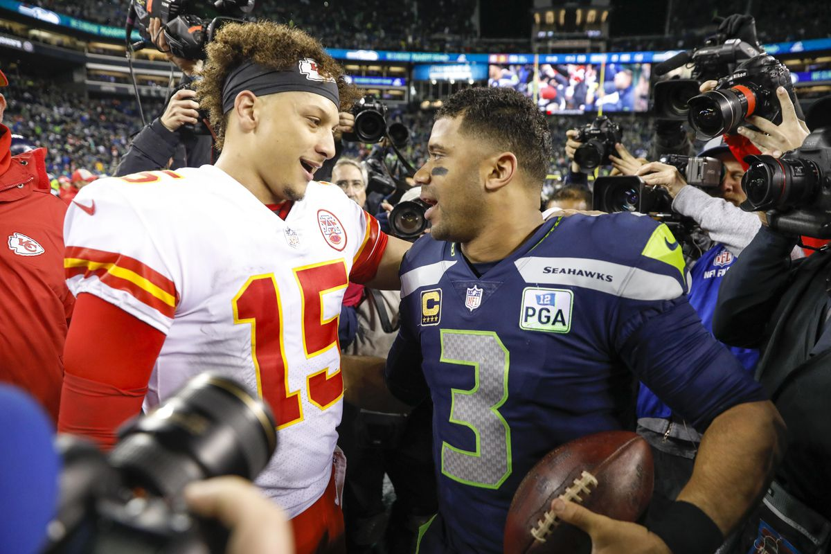 Kansas City Chiefs quarterback Patrick Mahomes greets Seattle Seahawks quarterback Russell Wilson following a 38-31 Seattle victory at CenturyLink Field.