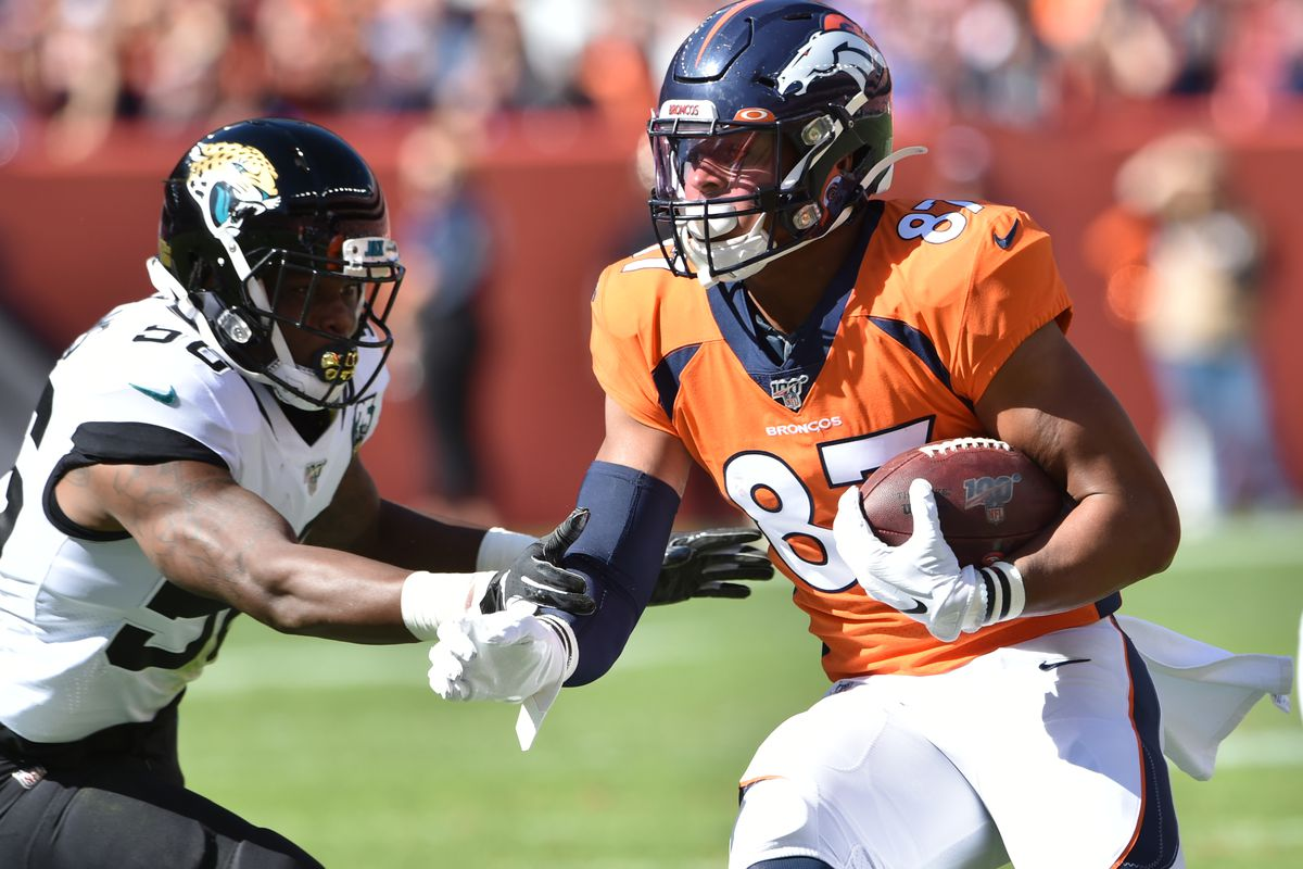 Denver Broncos tight end Noah Fant avoids the tackle of Jacksonville Jaguars linebacker Quincy Williams on his way to his touchdown at Empower Field at Mile High.