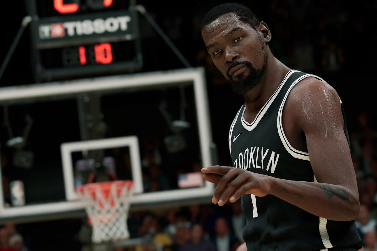 Kevin Durant of the Brooklyn Nets gestures to the camera in front of a basketball goal