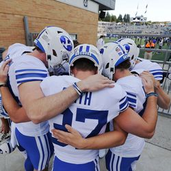 Brigham Young Cougars players pray prior to warming up in Logan on Friday, Oct. 1, 2021.