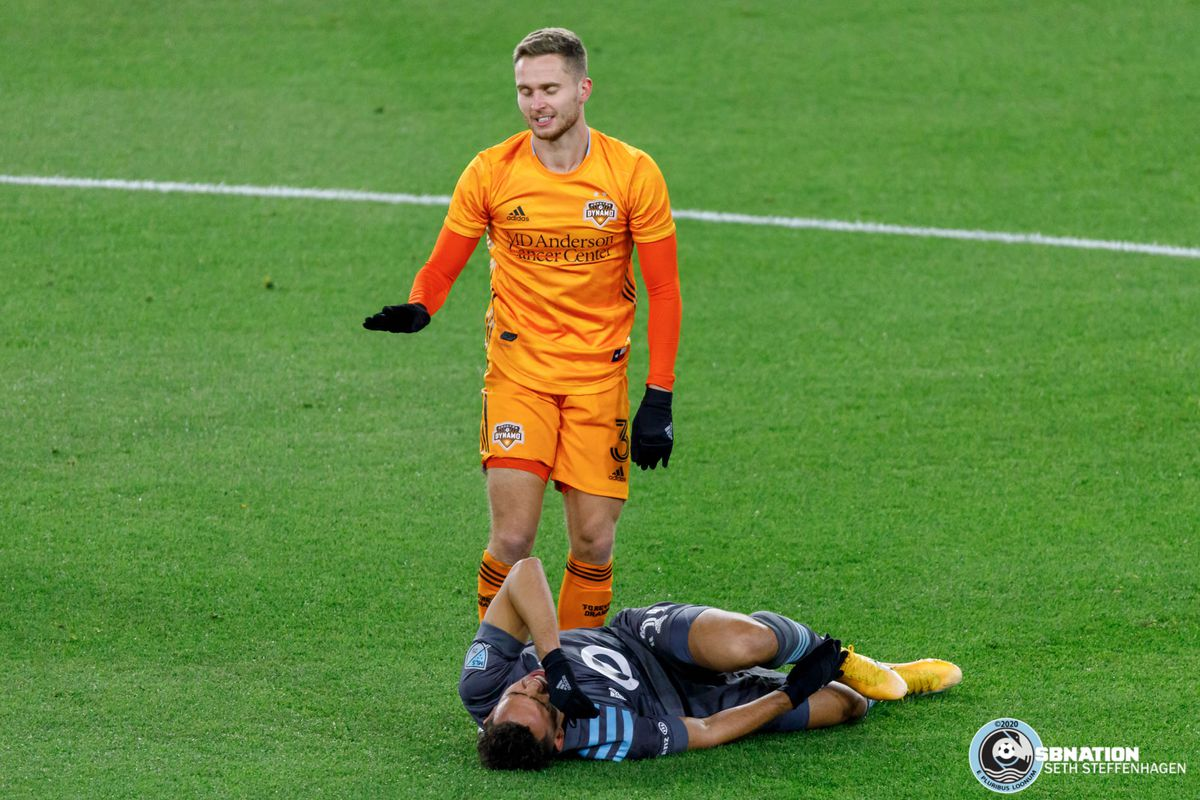 October 18, 2020 - Saint Paul, Minnesota, United States - Minnesota United midfielder Hassani Dotson (31) is injured after a slide tackle by Houston Dynamo defender Adam Lundkvist during the match at Allianz Field.