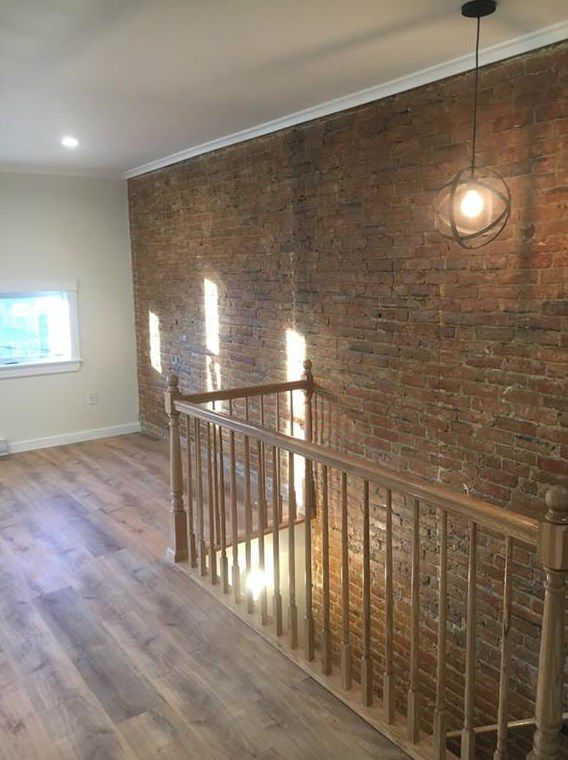 An empty upstairs room off a stairwell.