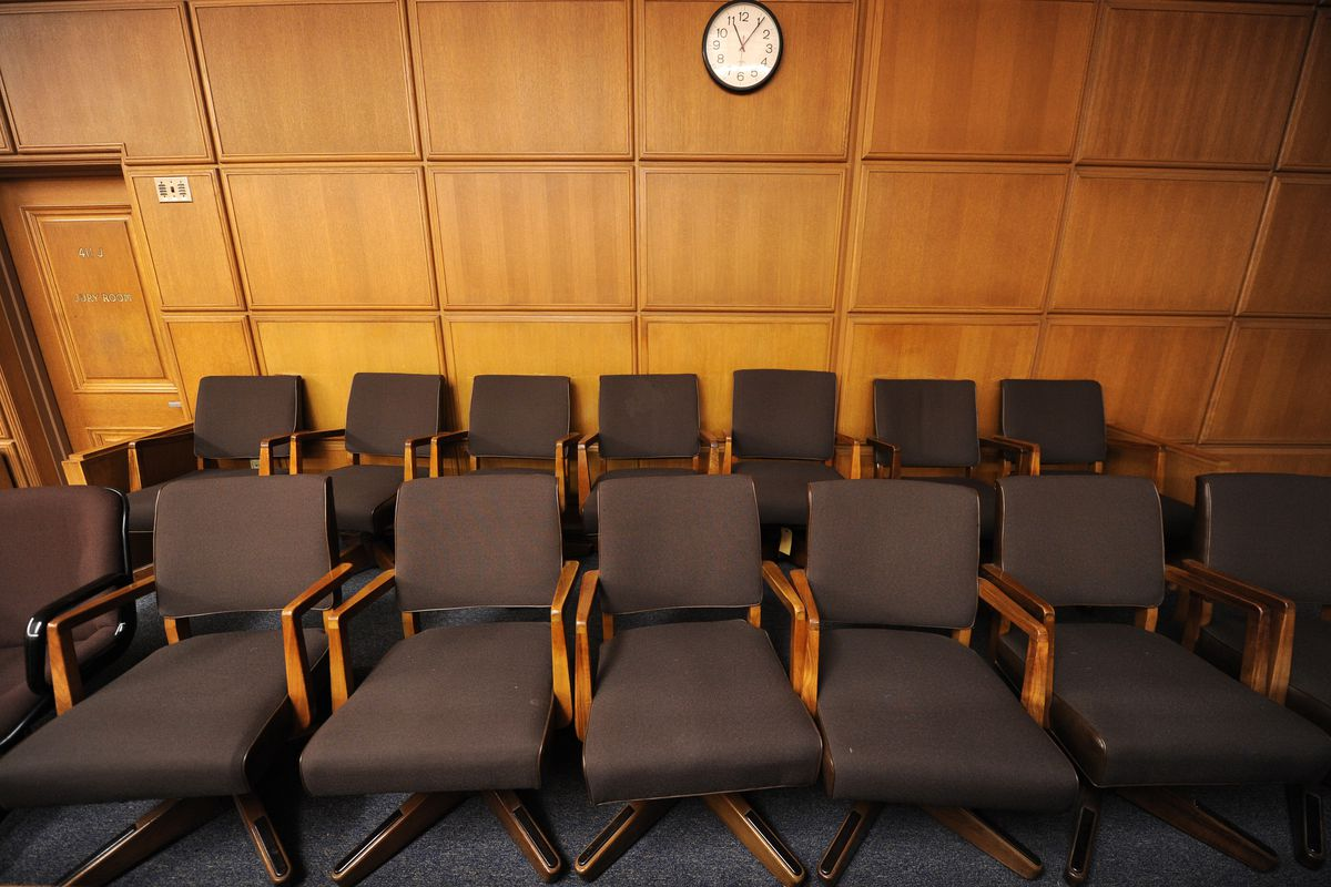 A view of the jury box in a courtroom.