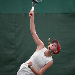 Woods Cross High School's Sage Bergeson serves as she and Highland's Dylan Lolofie battle for the 5A tennis state championship at Salt Lake Tennis & Health Club on Saturday, Oct. 9, 2021.