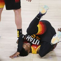 Utah Jazz guard Donovan Mitchell (45) falls and is slow getting up against the LA Clippers during the NBA playoffs in Salt Lake City on Thursday, June 10, 2021. The Jazz won 117-111.