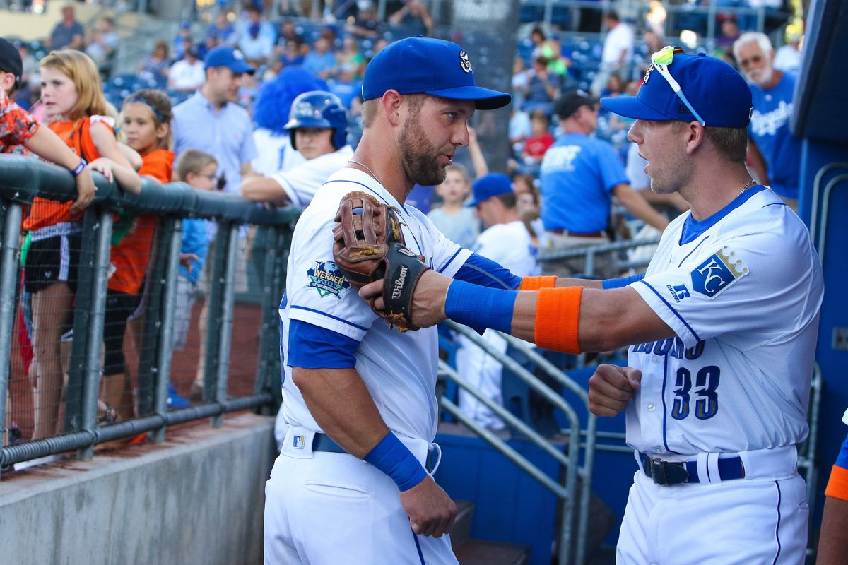 Alex Gordon and Hunter Dozier having some kind of moment in the Omaha dugout.