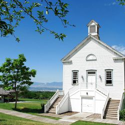 While the original 1868 Pine Valley Chapel is still in use in rural southern Utah, a picturesque replica is a centerpiece of the recreated pioneer village at This Is the Place Heritage Park.