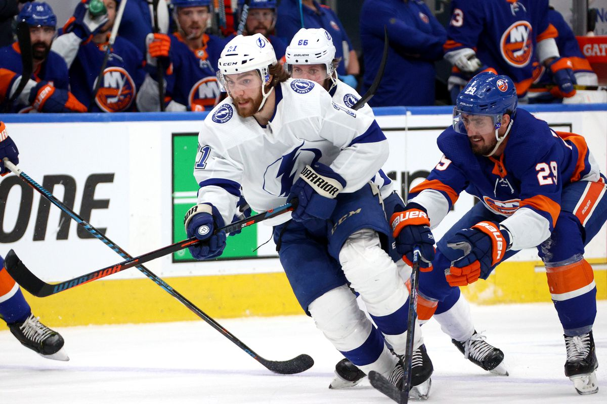 Brayden Point of the Tampa Bay Lightning skates with the puck as Brock Nelson of the New York Islanders pursues the play in the third period of Game Six of the Eastern Conference Final of the 2020 NHL Stanley Cup Playoffs between the Tampa Bay Lightning and the New York Islanders at Rogers Place on September 17, 2020 in Edmonton, Alberta.