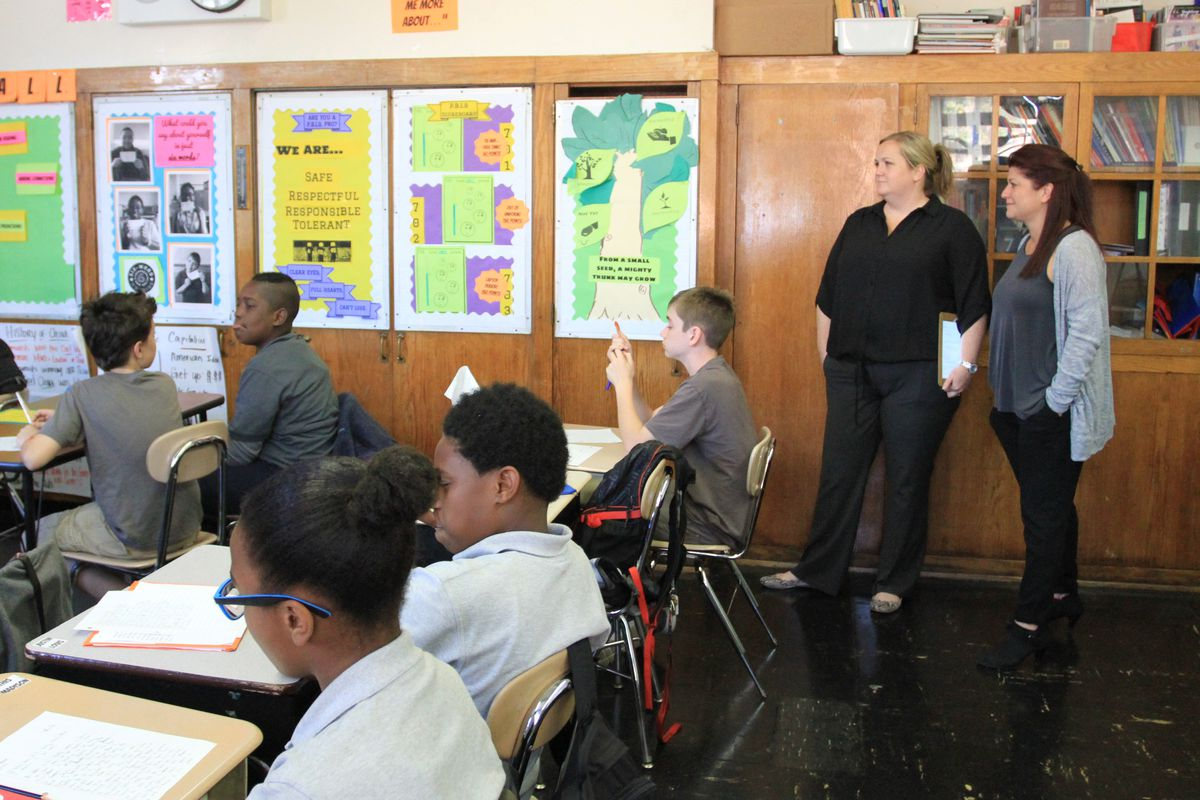 Carroll Gardens School for Innovation's current and former principals Noreen Mills (left) and Deanna Sinito (right) oversee a class.