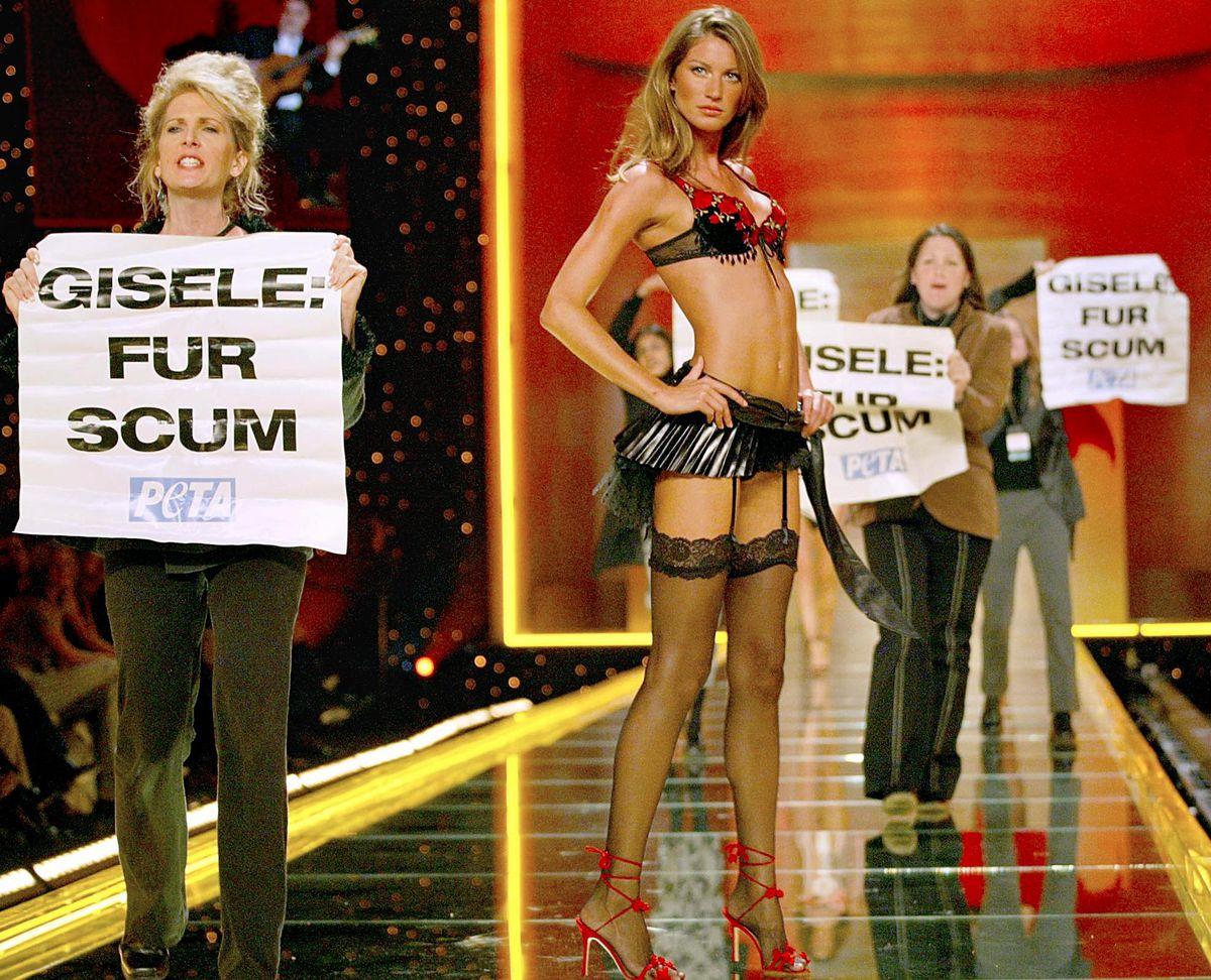 d09fb33ef93 PETA protesters rush the stage as Gisele Bundchen poses during the  Victoria s Secret fashion show in 2002. Timothy Clary AFP Getty Images