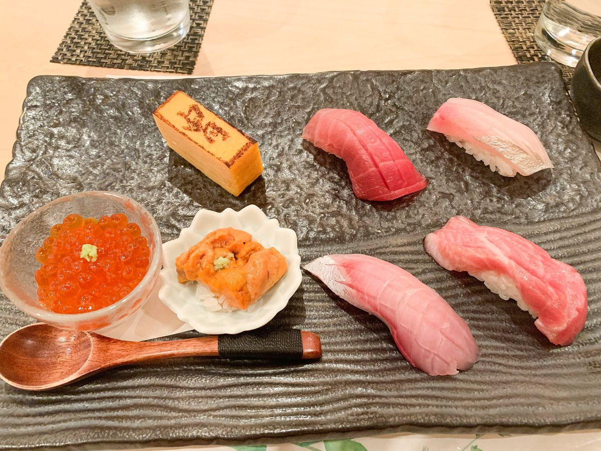 A gray plate with sushi
