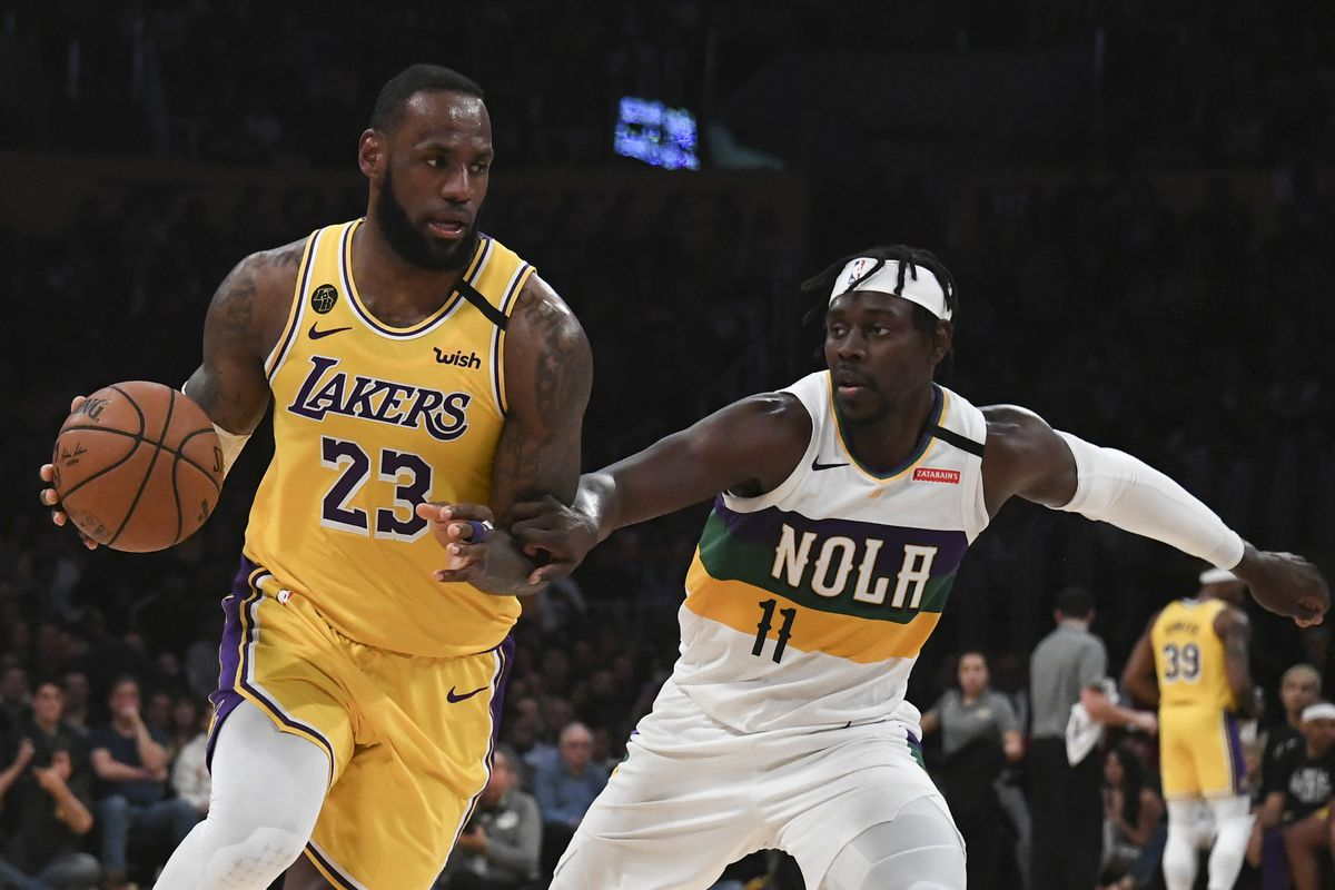 Los Angeles Lakers forward LeBron James drives to the basket while New Orleans Pelicans guard Jrue Holiday defends during the second half at Staples Center.