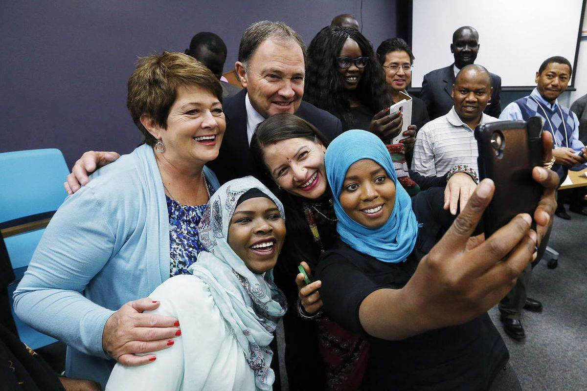Utah Governor Gary Herbert and first lady Jeanette Herbert take a selfie with refugees Jawaher Fadhel, Zakiya Ali and Parmila Dulal at the Utah Refugee Education and Training Center in Salt Lake City Tuesday, Nov. 10, 2015. The newly opened Refugee Center