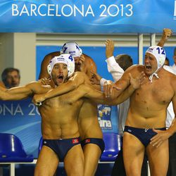 Miklos Gor-Nagy (C) and Balazs Hara of Hungary celebrate after the Water Polo Men's Gold Medal Match between Hungary and Montenegro.