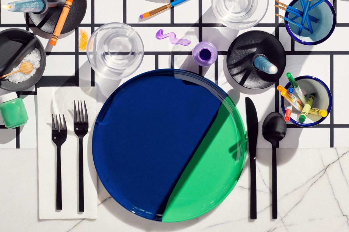 Colorful plates on table cloth.