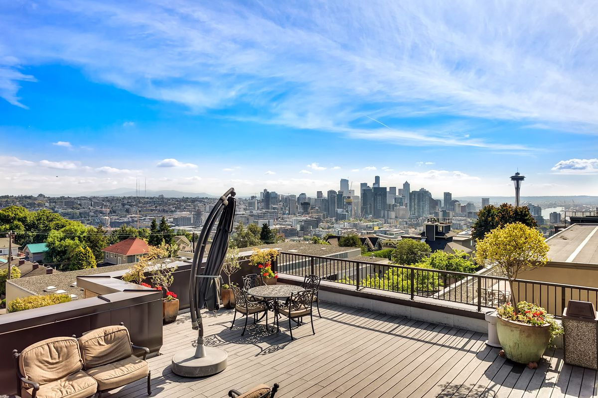 This Queen Anne High School Condo Comes With A Little