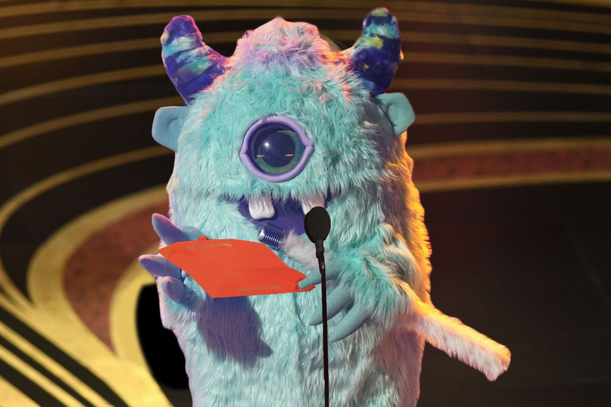 Monster presenting an Oscar