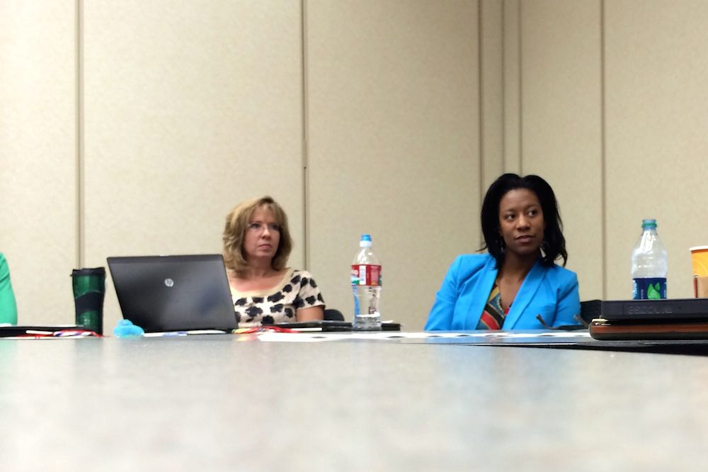 Jocelyn Stephens, right, listens during a meeting of P-20 Learning Community directors July 31. In her new role, Stephens will coordinate a support team for 10 schools in the suburban school district.