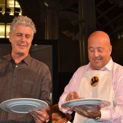 Anthony Bourdain and Andrew Zimmern with their finished dishes
