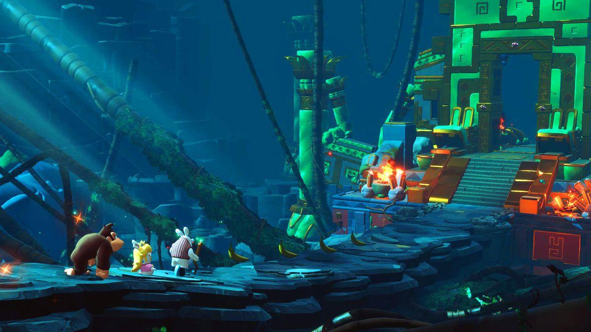 Mario + Rabbids Kingdom Battle: Donkey Kong Adventure - Donkey Kong, Rabbid Peach and Rabbid Cranky exploring a dungeon