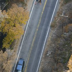 Officials investigate a fatal bike accident up Millcreek Canyon on Thursday, Oct. 24, 2013.