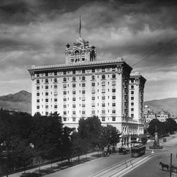 The Hotel Utah juts aganist the sky in early photo, which captures on film, trolley and horse and buggy near the hotel.  This photo ran in the paper's Sept. 26, 1976 edition.