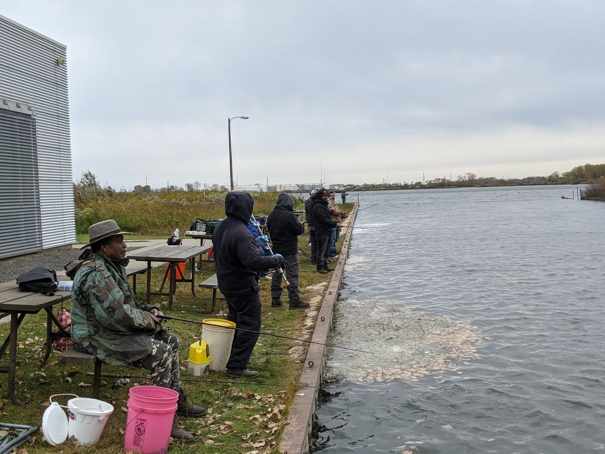 On opening day of inland trout season Saturday, anglers lined the north edge of the inlet at Wolf Lake where trout were stocked. Credit: Dale Bowman