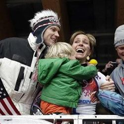 Noelle Pikus-Pace of the United States hugs her husband, Janson Pace, and her children, Traycen, left, and Lacee, right, after she won the silver medal during the women's skeleton competition at the 2014 Winter Olympics, Friday, Feb. 14, 2014, in Krasnaya Polyana, Russia.