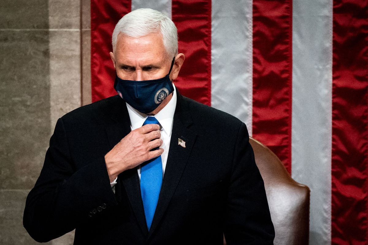 Mike Pence in a mask in front of an American flag.