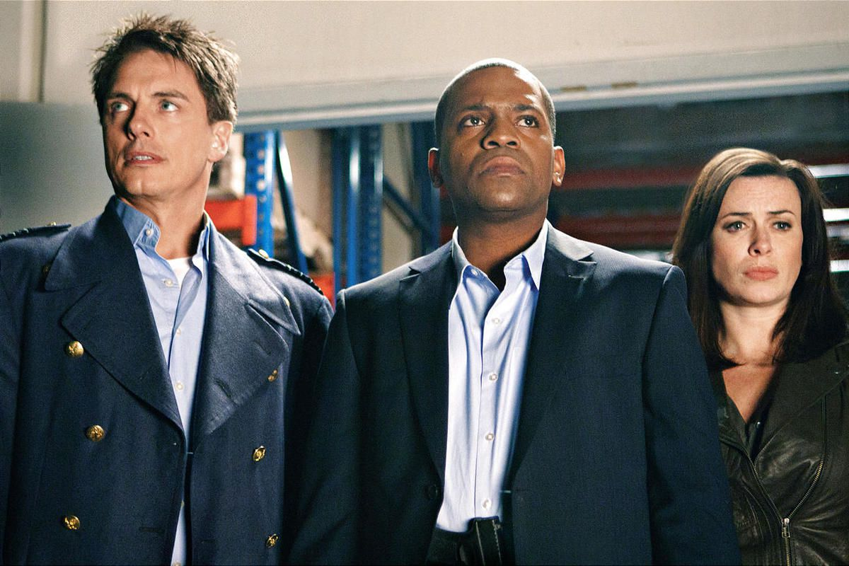 """John Barrowman as Captain Jack Harkness, Mekhi Phifer as CIA agent Rex Matheson and Eve Myles as Gwen Cooper in """"Torchwood: Miracle Day,"""" which airs Friday on Starz."""